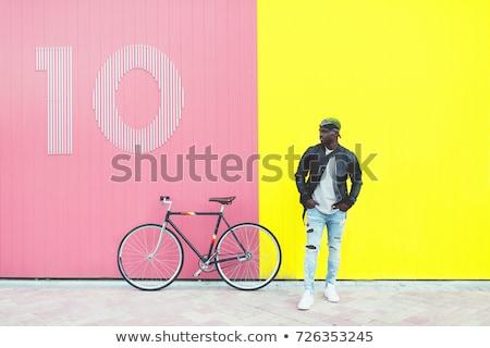 Boldog fiatal afrikai fickó sétál bicikli Stock fotó © deandrobot