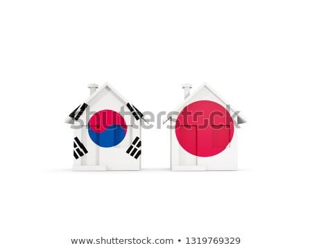 Iki evler bayraklar Güney Kore Japonya yalıtılmış Stok fotoğraf © MikhailMishchenko