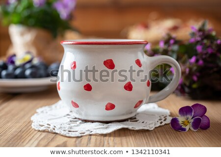 Polka dot mug with flowers and blueberries stock photo © madeleine_steinbach