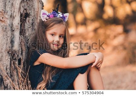 Girl toddler looking at unicorn Stock photo © colematt