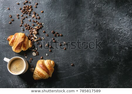 Fresh croissants and coffee beans Stock photo © karandaev