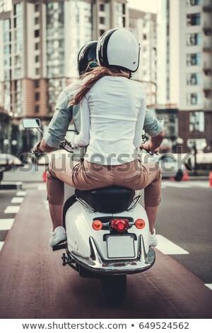 Ver de volta alegre casal capacetes equitação Foto stock © deandrobot