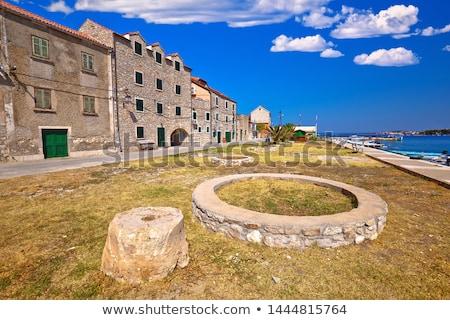 old stone houses aon krapanj island waterfront stock photo © xbrchx