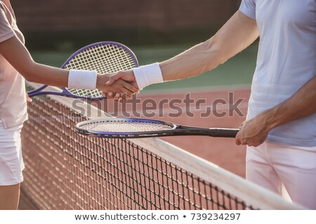 Two young female tennis players shaking hands Stock photo © pressmaster
