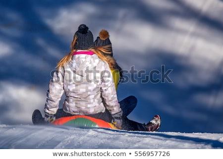 happy kids sliding on sled down hill in winter Stock photo © dolgachov