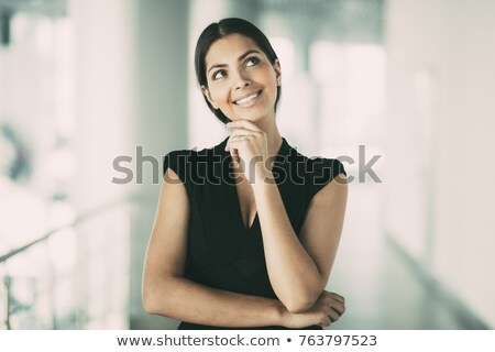Thoughtful young woman with a look of anticipation Stock photo © Giulio_Fornasar