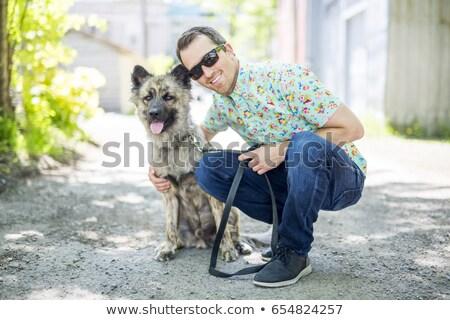 Mosolyog férfi sétál díszállat környék barátok Stock fotó © Lopolo