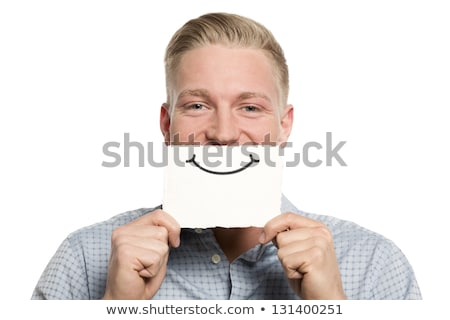 Person holding card in front of his mouth Stock photo © ra2studio
