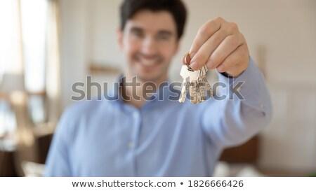 ház · kulcs · kéz · új · otthon · tulajdonos · épület - stock fotó © pressmaster
