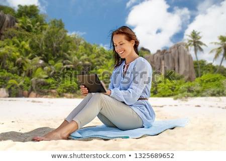 happy woman over tropical beach background stock photo © dolgachov