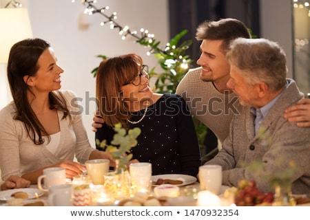happy family having tea party at home Stock photo © dolgachov