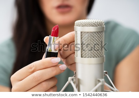Woman Using Lipstick On Microphone To Make Asmr Sounds Stock photo © AndreyPopov