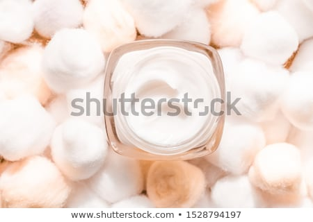 Luxury face cream for sensitive skin and eco cotton balls on bac Stock photo © Anneleven