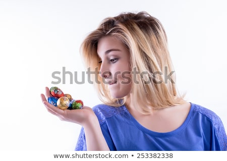 close up of girl holding chocolate easter eggs Stock photo © dolgachov