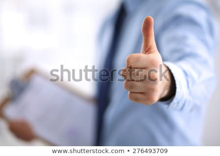 business people showing ok hand sign at office Stock photo © dolgachov