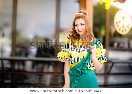 A woman walks down the street along tourist cafes in bright attractive clothes Stock photo © ElenaBatkova