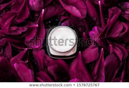 Sensitive skincare moisturizer cream on purple flower petals bac Stock photo © Anneleven