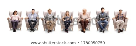 Row of happy young friends relaxing in comfortable armchairs in cinema Stock photo © pressmaster