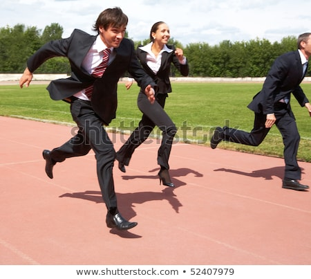 Image of happy woman and man running on stadium outdoors Stock photo © deandrobot