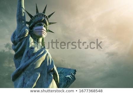 Statue of Liberty in medical mask. Coronavirus in USA. Coronavir Stock photo © popaukropa