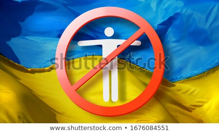 Warning sign with crossed out man on a background of Ukrainian flag. Stock photo © artjazz