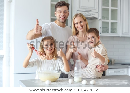 father with daughters showing thumbs up at home Stock photo © dolgachov