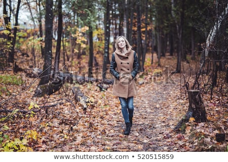 Woman Walking Through The Countryside In Autumn Time Foto stock © Lopolo