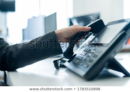 Telephone receiver in hand Stock photo © caimacanul