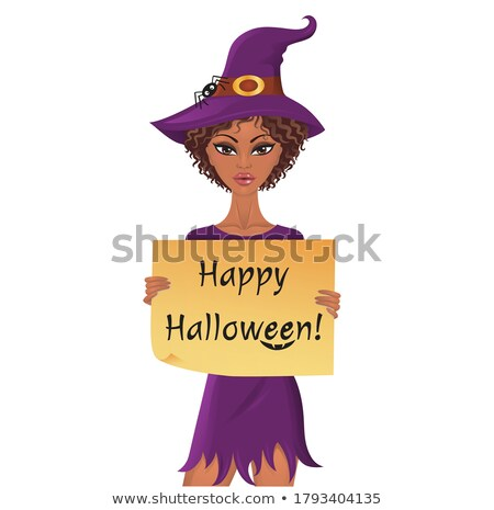 Cute afro-american witch holding a piece of paper with happy halloween text. Stock photo © oksanika