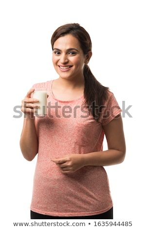 Woman holding glass of milk Stock photo © photography33