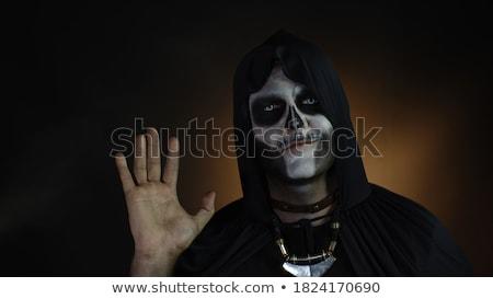 spooky skeleton salute stock photo © searagen
