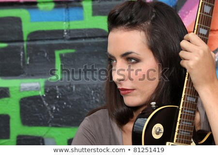 female guitarist against a graffiti background stock photo © photography33