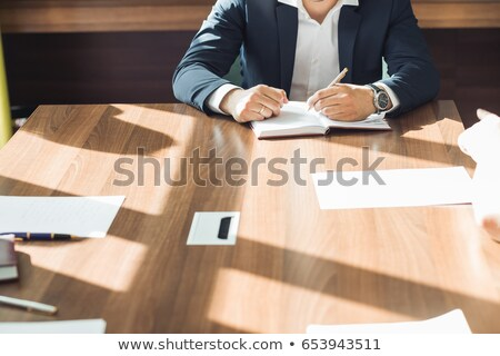 Man happily working at his desk Stock photo © photography33