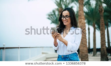 Businesswoman talking on her mobile phone on the quay Stock photo © photography33