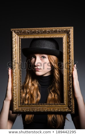 Redhead girl with black picture frame Stock photo © photography33