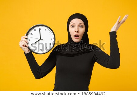 Upset woman sat with clock Stock photo © photography33