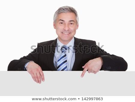 человека · Постоянный · за · плакат · изолированный · белый - Сток-фото © stockyimages
