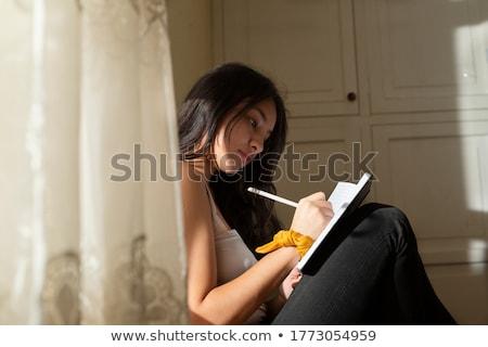 young peruvian woman writing stock photo © ildi