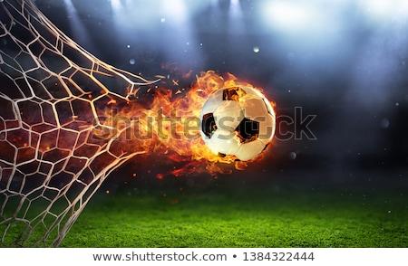 Foto stock: Fiery Soccer Ball On Field