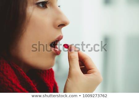 Mujer píldora boca cara ojos Foto stock © wavebreak_media
