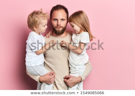 Playful young man and two sad blonde Stock photo © acidgrey