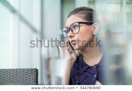 Careful woman on phone Stock photo © photography33