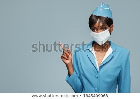 スチュワーデス ポインティング 指 画像 笑みを浮かべて 女性 ストックフォト © dolgachov