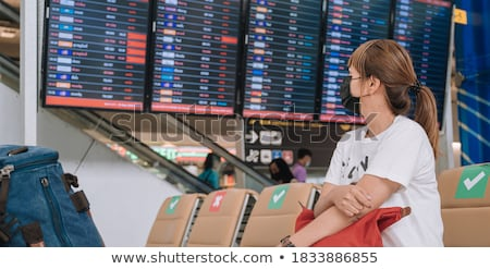 man sitting on suitcase with travel destination board Stock photo © compuinfoto