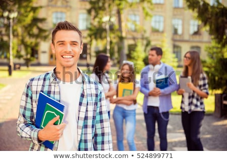 Male student with group of classmates on background working at t stock photo © HASLOO