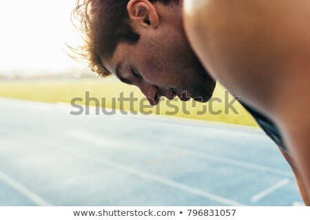 Close-up of man bending Stock photo © zzve