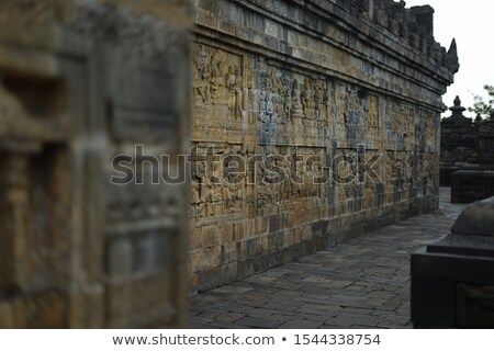 Medieval carving - Buddha. Borobudur temple. Stock photo © pzaxe