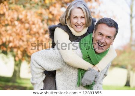 image of Senior man giving woman piggyback ride stock photo © get4net