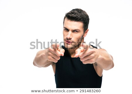 young serious muscular man pointing at you stock photo © stepstock