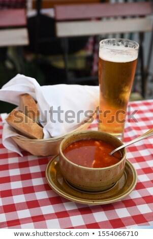 Stock photo: Fishermen fish in a soup mug